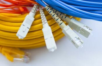 fiber phone and category cables in a pile